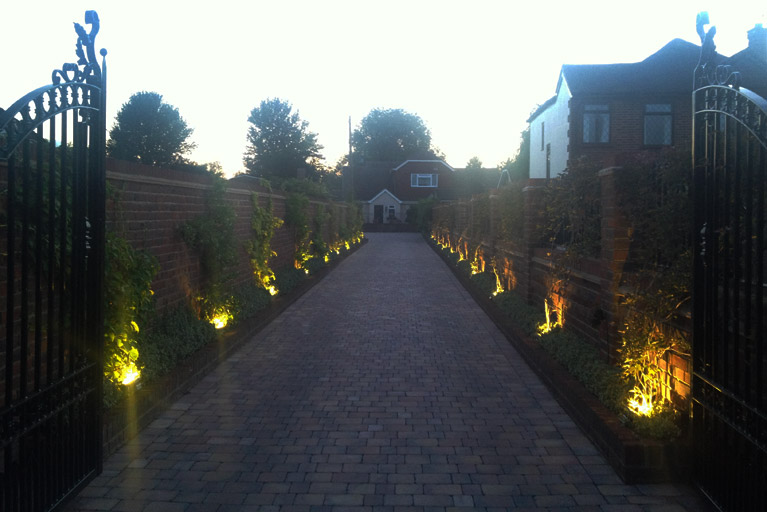 sage builds and installs custom driveway lighting system sage